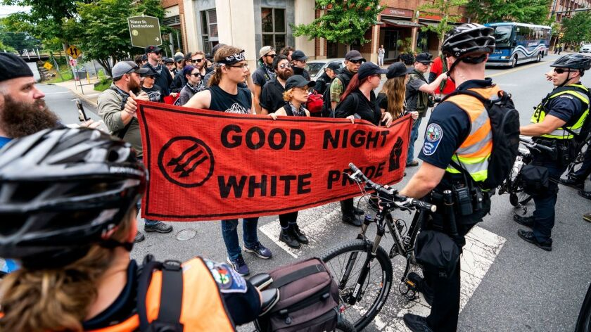 Anti-fascists march through downtown Charlottesville, Va., on Saturday as the city marks the anniversary of last year's deadly Unite the Right rally.