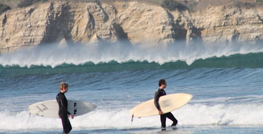 Santa Ana winds clipped off the top of waves Wednesday at La Jolla Shores.