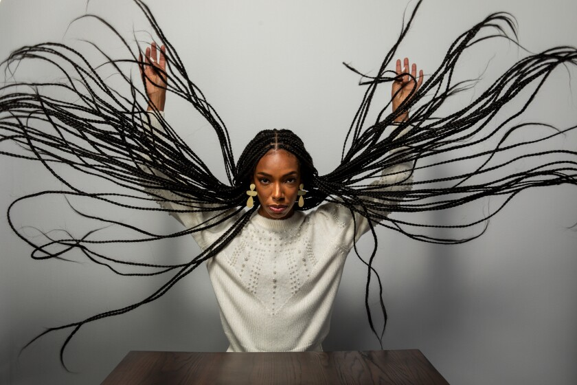 "Elle Lorraine, star of ""Bad Hair,"" with long braids fanned out, at the Sundance Film Festival on Jan. 24, 2020."