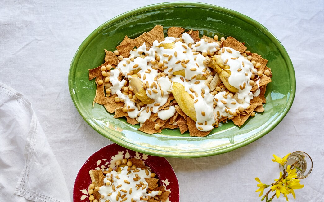 Garlicky yogurt tops this dish of stewed poultry and chickpeas over toasted pita bread.
