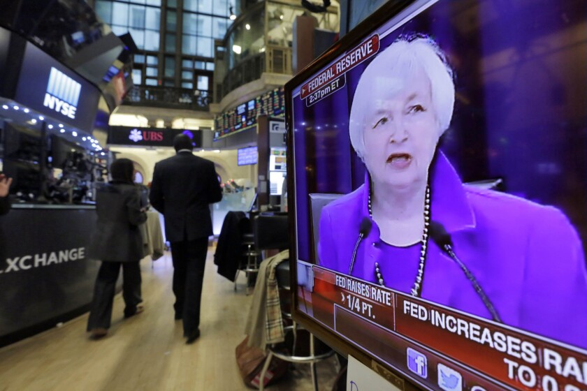 Federal Reserve Chairwoman Janet L. Yellen's Washington news conference is shown on a television screen on the floor of the New York Stock Exchange in December.