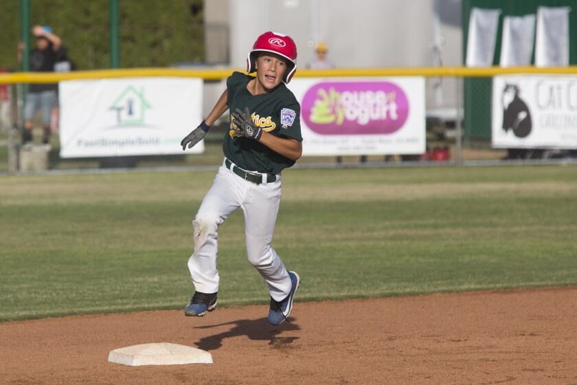 Costa Mesa American's Michael Buley rounds second base during the District 62 Tournament of Champion