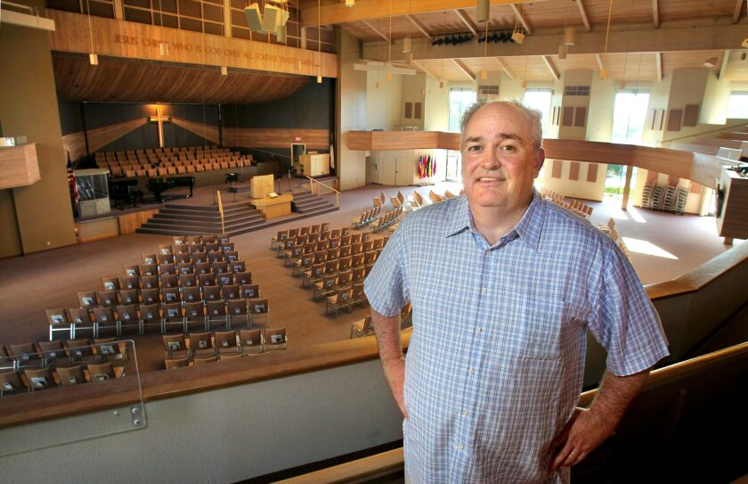 Portrait of Pastor Alvin Helms, of Carlsbad Community Church, in the church's 1,450 seat Worship Center that was completed in 1991.