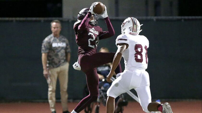 Laguna Beach receiver Kai Ball makes a catch for big gain during Pac 4 league game against Ocean Vie