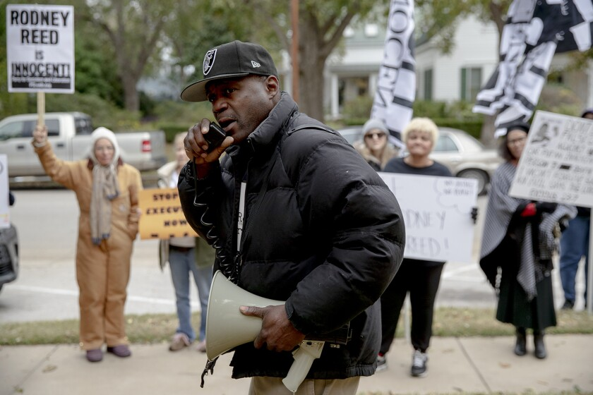 Rodrick Reed leads a chant during a protest against the execution of his brother Rodney Reed.