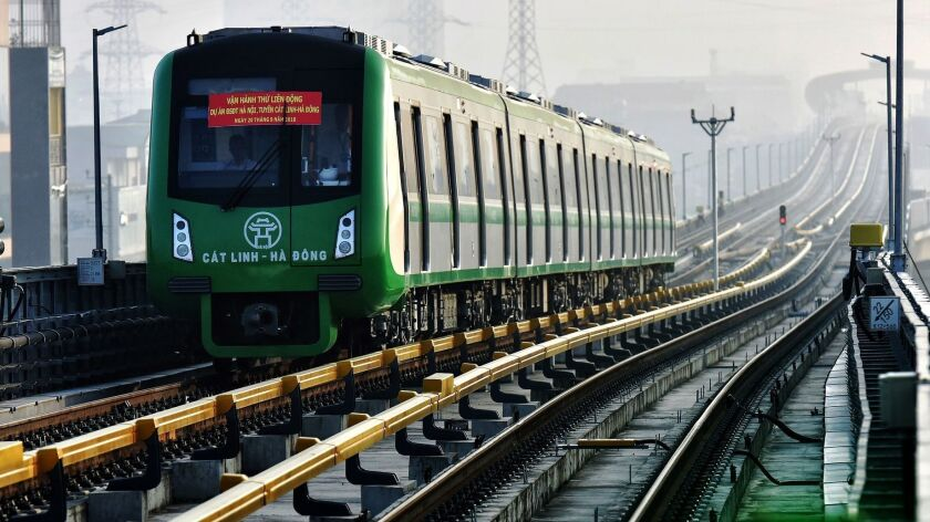 A train makes a test run on the first elevated railway line running from Cat Linh to Ha Dong in Hanoi on Sept. 20, 2018. Hanoi's first modern urban train transportation was built by China Railway Sixth Group Co., a Chinese state-owned firm.