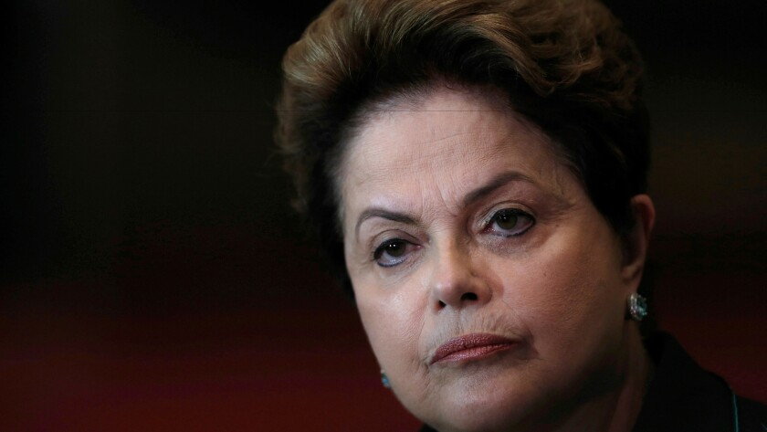 Dilma Rousseff listens to a question during an Oct. 6, 2014, reelection campaign news conference at the Alvorada Palace in Brasilia, Brazil.