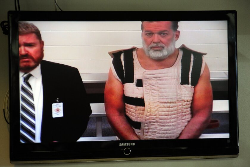 Colorado Springs shooting suspect Robert Dear, with public defender Dan King, appears via video before a judge at the El Paso County Criminal Justice Center on Nov. 30 in Colorado Springs, Colo.