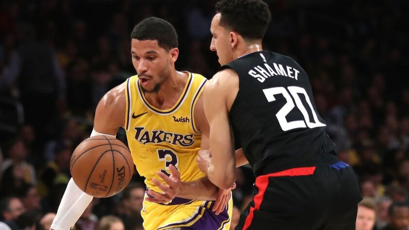 Lakers guard Josh Hart tries to regain control of the ball as he drives past Clippers guard Landry Shamet during the second half Monday.