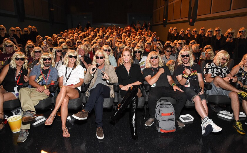 """Actress Charlize Theron (center) attends the """"Atomic Blonde"""" San Diego Comic-Con fan screening on July 22, 2017. (Michael Kovac/Getty Images for Focus Features)"""