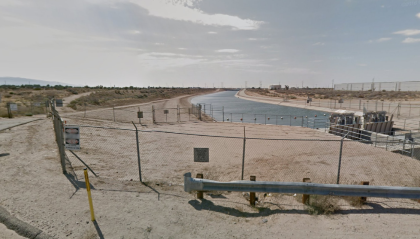 A section of the California Aqueduct near where a man died Tuesday while trying to rescue his dog from the canal.