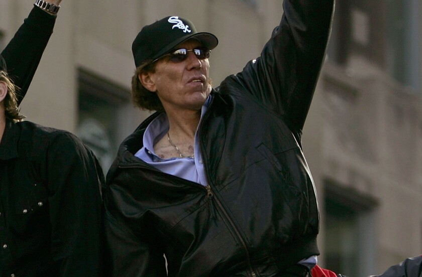 Chicago White Sox radio broadcaster Ed Farmer waves to the crowd during the White Sox World Series victory parade in October 2005.