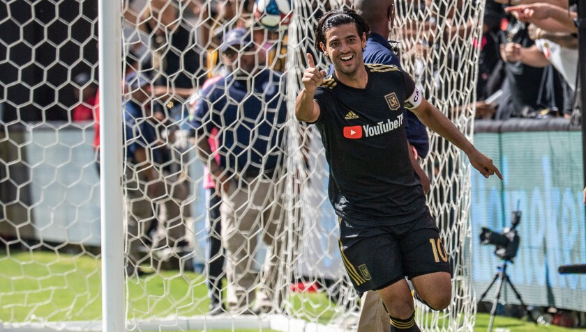 LAFC star Carlos Vela celebrates after scoring his third goal against Colorado in a 3-1 win on Sunday.