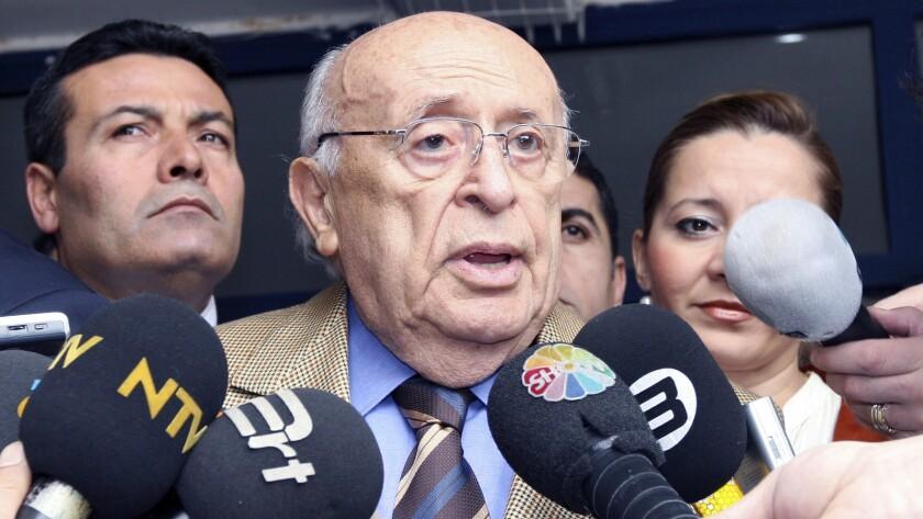 Former Turkish President Suleyman Demirel speaks to the media at a polling station in Ankara, Turkey, in 2007.