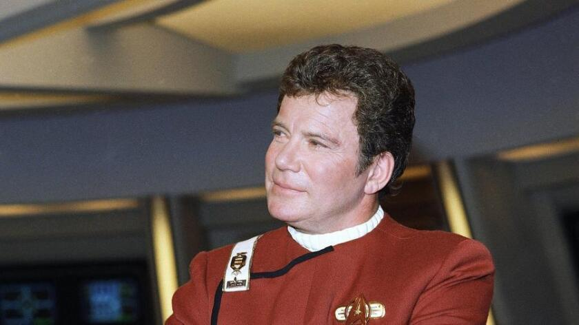 "William Shatner appears dressed as Captain Kirk at a photo opportunity promoting the Paramount Studios film ""Star Trek V: The Final Frontier."" Shatner stars in and directs this film on Dec. 28, 1988. (/ AP Photo/Bob Galbraith)"