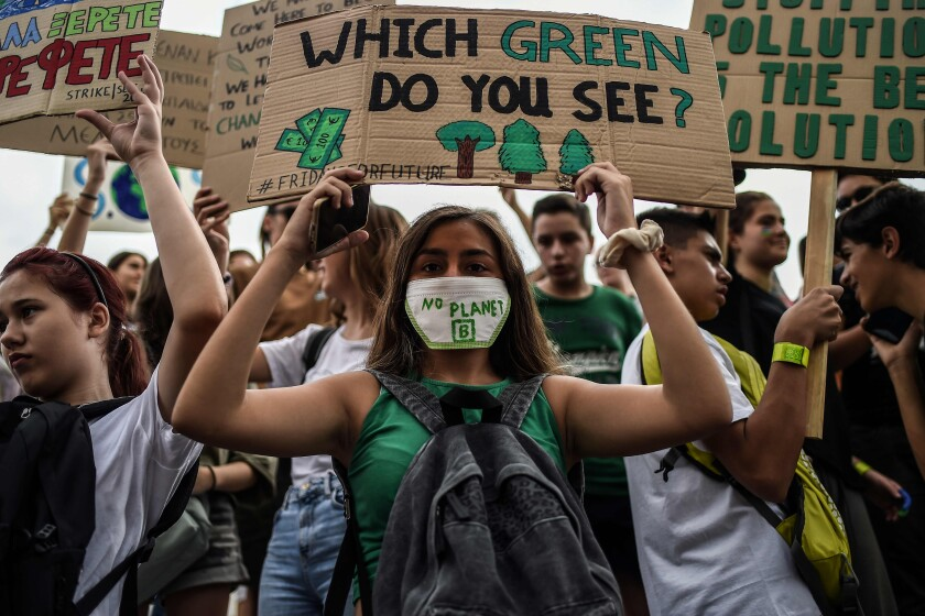 """People holding placards reading messages for the safeguard of the environment take part in a demonstration rally in front of the Greek Parliament during the """"Fridays for climate"""" to protest against climate change in in Athens on September 20, 2019. (Photo by ANGELOS TZORTZINIS / AFP)ANGELOS TZORTZINIS/AFP/Getty Images ** OUTS - ELSENT, FPG, CM - OUTS * NM, PH, VA if sourced by CT, LA or MoD **"""