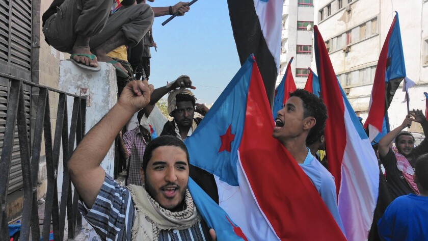 Demonstrators in the port city of Aden carry the flag of southern Yemen. Those who support breaking away from northern Yemen marched in Aden's Tawahi district.