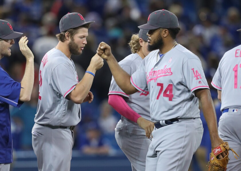 Dodgers closer Kenley Jansen (74) celebrates a victory over the Blue Jays on May 8 with starting pitcher Clayton Kershaw.