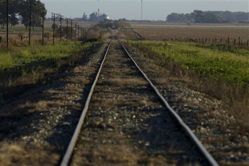 In this July 14, 2012 photo, train tracks cross a farm near Pergamino, Argentina. China agreed to cooperate in financing the modernization of the Belgrano Cargas railway, which connects Argentina capital Buenos Aires with 13 of Argentina's 23 provinces, including the main soybean producing areas  i