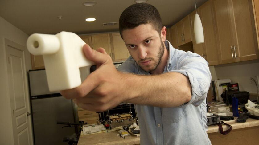 Cody Wilson with the Liberator, the first completely 3-D-printed handgun, in 2013 at his home in Austin, Texas.