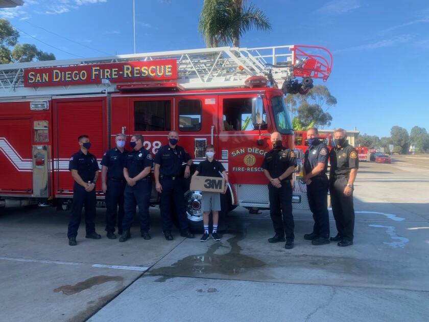 Ezra Granet, center, donated masks to San Diego Fire-Rescue.