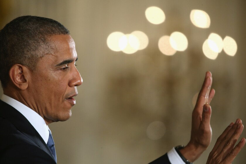 President Obama said at a news conference Wednesday that he would draw a line against any legislation to repeal his signature healthcare law. Republicans campaigned heavily against it in this year's election.