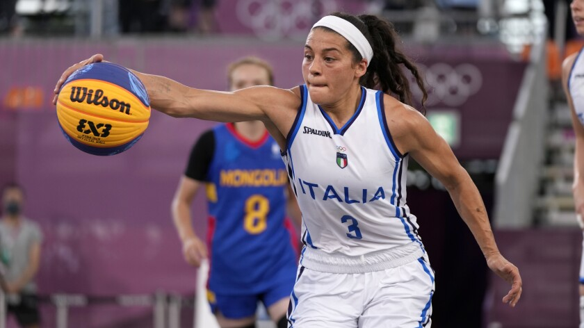 Italy's Rae Lin D'Alie, of Wisconsin, plays 3-on-3 basketball at the Tokyo Olympics