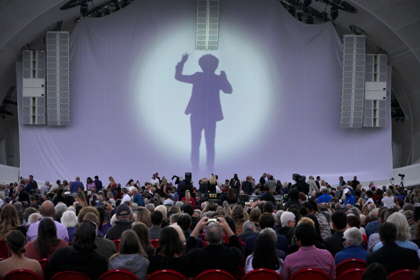 A silhouette of Rafael Payare was projected on the stage