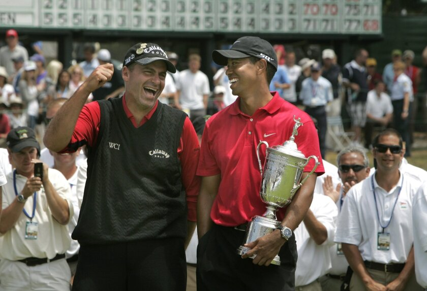 Tiger Woods holds the trophy and shares a laugh with Rocco Mediate after winning the U.S. Open at Torrey Pines on June 16, 2008. U-T file photo