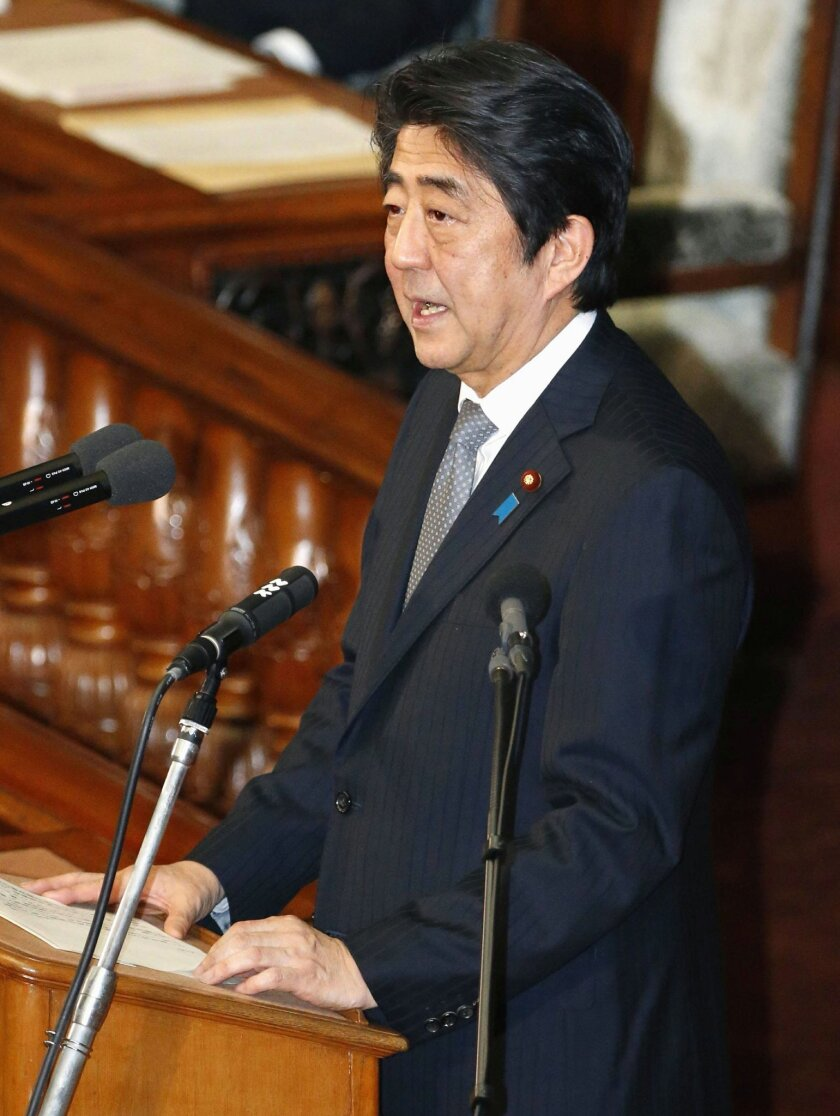 Japanese Prime Minister Shinzo Abe delivers a speech during the plenary session of the lower house in Tokyo, Tuesday, Feb. 9, 2016. Japan's parliament condemned North Korea's long-range rocket launch Tuesday, calling it a serious provocation against international peace and demanding that the commun