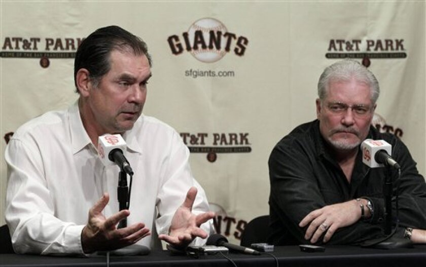 San Francisco Giants manager Bruce Bochy, left, addresses the media as general manager Brian Sabean listens in during a baseball news conference in San Francisco, Friday, Nov. 5, 2010. (AP Photo/Jeff Chiu)