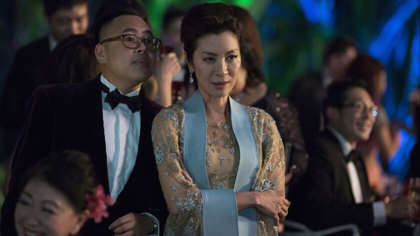 This image released by Warner Bros. Entertainment shows Nico Santos, left, and Michelle Yeoh in a sc