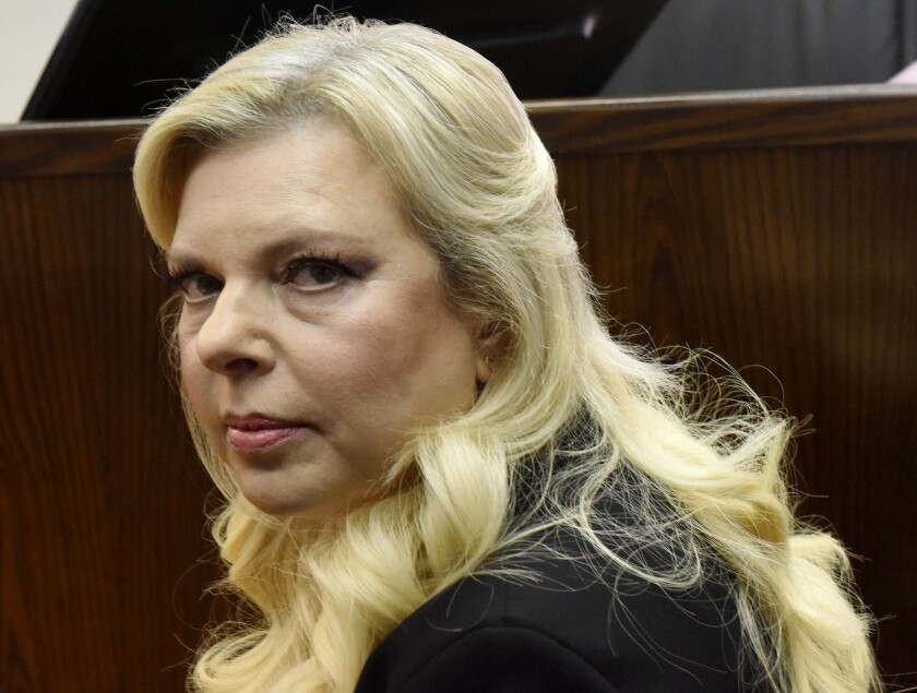 FILE - In this June 16, 2019 file photo, Sara Netanyahu, the wife of Israeli Prime Minister Benjamin Netanyahu, appears in the Magistrate Court, for a hearing on a plea deal over the misuse of state funds for meals at the premier's residence, in Jerusalem. Netanyahu may have violated the country's coronavirus lockdown by inviting a hairdresser into the official residence last week to prepare her for a public service video advocating the wearing of masks. The Yediot Ahronot newspaper reported Wednesday, Oct. 7, 2020, that Sara Netanyahu had a hairdresser visit on the eve of the festive Sukkot holiday. (Debbie Hill/Pool Photo via AP, File)