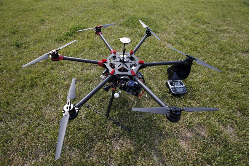 A hexacopter drone and controller at a demonstration at a farm and winery.
