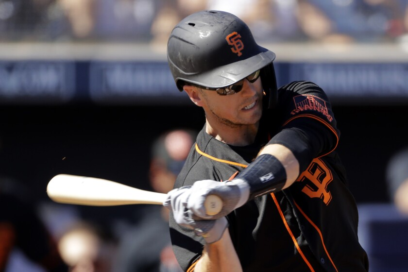 San Francisco Giants' Buster Posey bats in a spring training game.