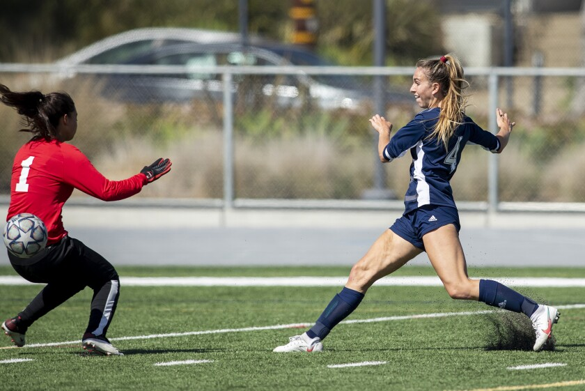 Newport Harbor's Kenna Robar, right, shown shooting against rival CdM on April 6, had a goal in the Sailors' 3-1 win.