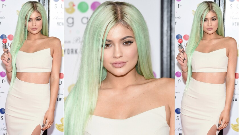 Kylie Jenner attends the opening of the Sugar Factory American Brasserie in New York City on Wednesday. Oh yeah, she has green hair now, if you didn't notice.