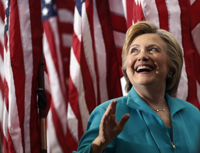 Democratic presidential candidate Hillary Clinton looks up to audience members as she leaves a campaign event at Truckee Meadows Community College in Reno, Nev., Thursday, Aug. 25, 2016. (AP Photo/Carolyn Kaster)
