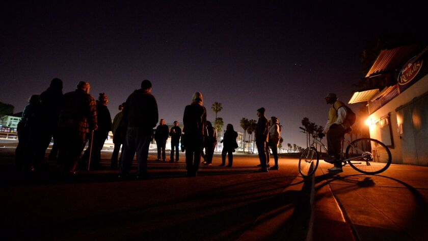 The city of Los Angeles has agreed to go before the Coastal Commission to defend its 30-year-old midnight curfew along 11 miles of shoreline. Above, the Venice boardwalk after dark.