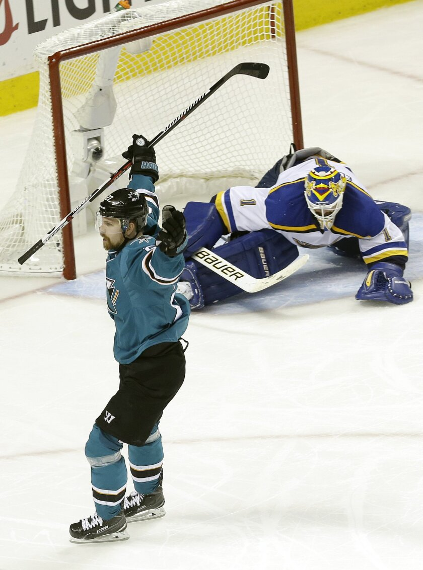 San Jose Sharks right wing Joonas Donskoi, foreground, from Finland, celebrates after scoring a goal against St. Louis Blues goalie Brian Elliott, rear, during the third period in Game 6 of the NHL hockey Stanley Cup Western Conference finals in San Jose, Calif., Wednesday, May 25, 2016. The Sharks
