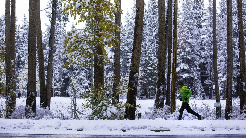 A man runs on a trail after a Sierra Nevada storm dropped nearly a foot of snow at Mammoth Mountain in November.