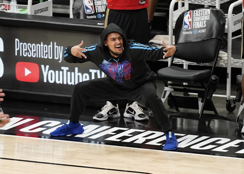 Hawks star Trae Young watched the last two Eastern Conference finals against the Bucks from the side.