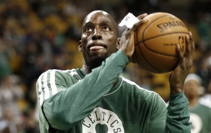 Boston Celtics' Kevin Garnett warms up for his first game since coming back from an injury before an NBA basketball game against the Washington Wizards in Boston, Sunday, April 7, 2013. (AP Photo/Winslow Townson)