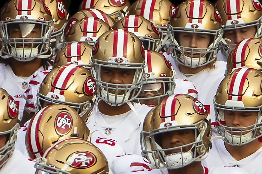 San Francisco 49ers gather before taking the field to play the New England Patriots on Oct. 25 in Foxborough, Mass.