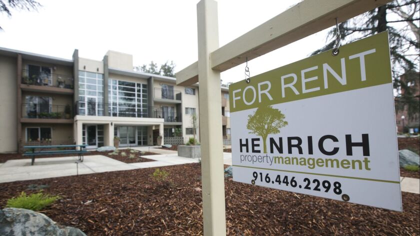 """FILE - In this Jan. 8, 2018, file photo """"For Rent"""" sign is posted outside an apartment building in"""