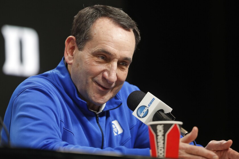 Duke head coach Mike Krzyzewski answers questions during a news conference in 2019.