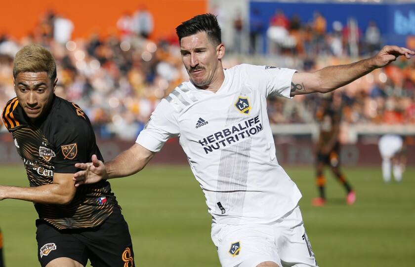 Galaxy defender Sacha Kljestan, right, races Houston Dynamo midfielder Memo Rodriguez to the ball during the Galaxy's season opener on Feb. 29.