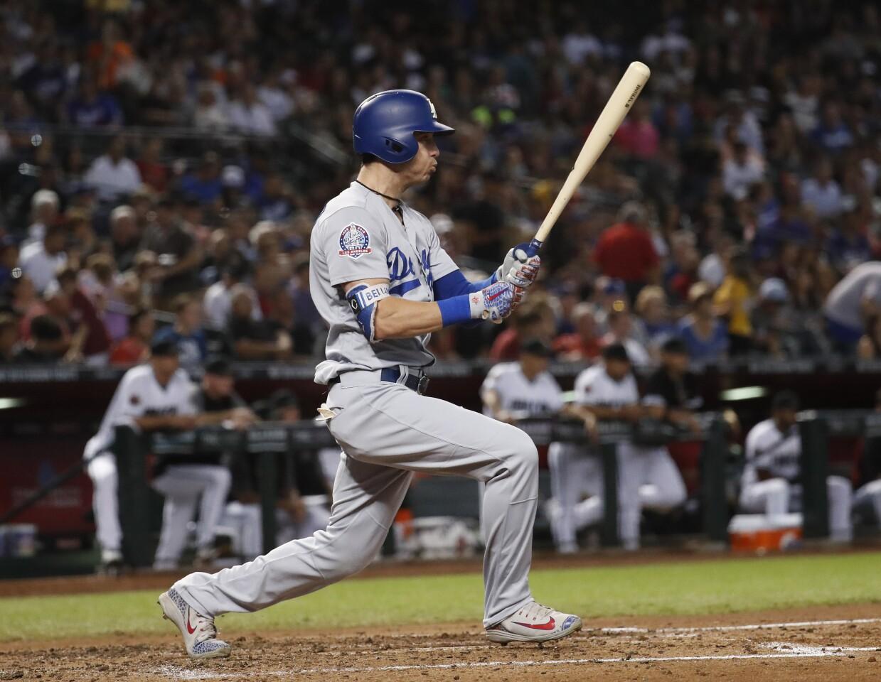 Los Angeles Dodgers first baseman Cody Bellinger hits against the Arizona Diamondbacks during the fifth inning of a baseball game, Tuesday, Sept. 25, 2018, in Phoenix. (AP Photo/Matt York)