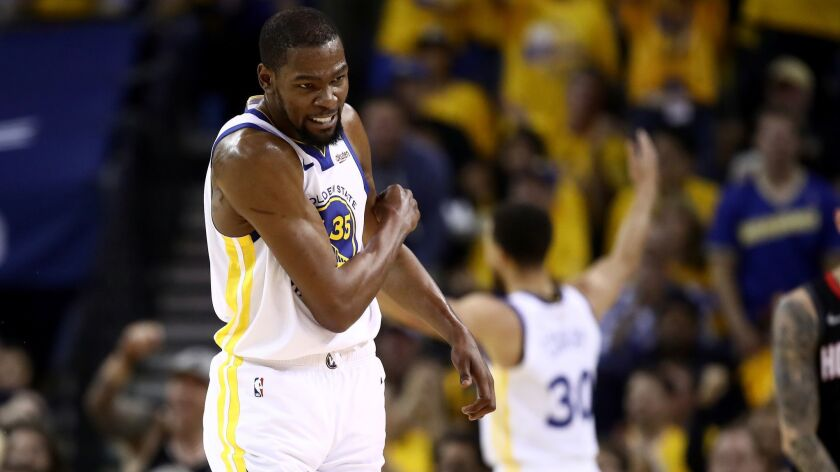 Golden State's Kevin Durant reacts after the Warriors scored a basket against the Houston Rockets during Game 5 of the Western Conference semifinals on May 8.