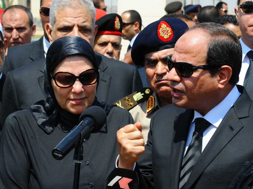 Egyptian President Abdel Fattah Sisi, right, speaks Tuesday at the Cairo funeral for Hisham Barakat, the top judicial official in charge of overseeing the prosecution of thousands of Islamists. Barakat died Monday in a car bombing.